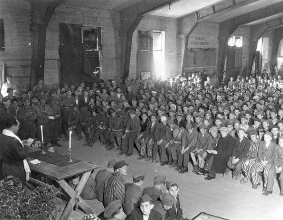 Depicted leading this Shabbat service shortly after the liberation of Buchenwald. There is something beyond moving about this image that shows the prisoners, still in their garb, still in their prison, but liberated and celebrating the most important day of the week.