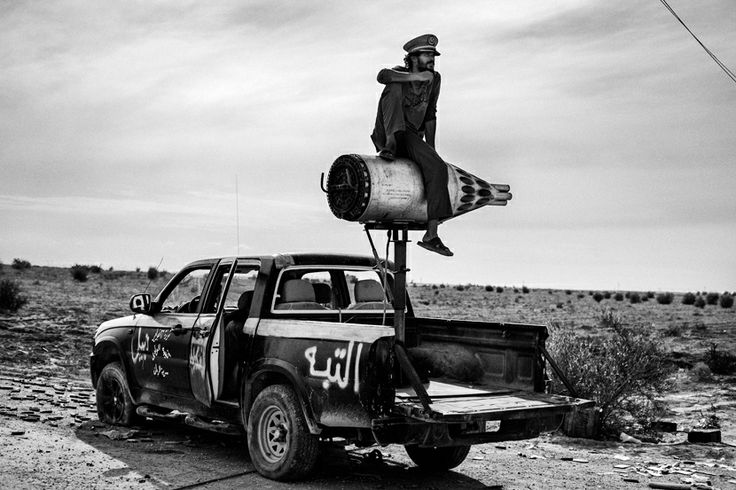 Fabio Bucciarelli - Sirte, October 2011. A revolutionary soldier sits on a rocket mounted on a pickup in the desert near Sirte. THE LIBYAN Esther Kofod www.estherkofod.com
