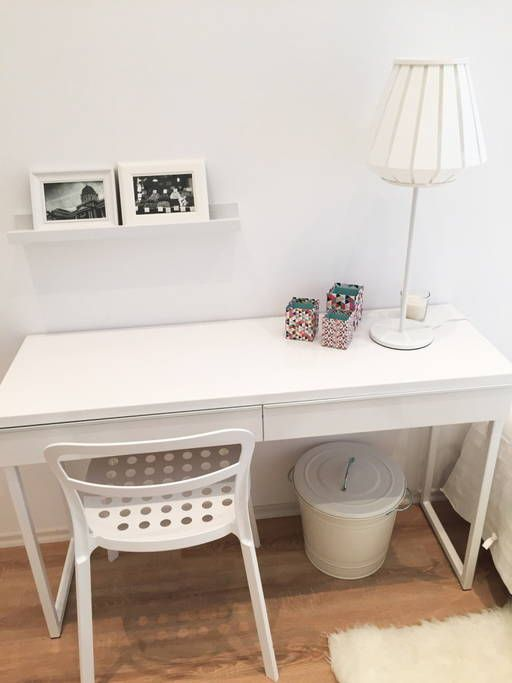 White desk and colorful boxes;