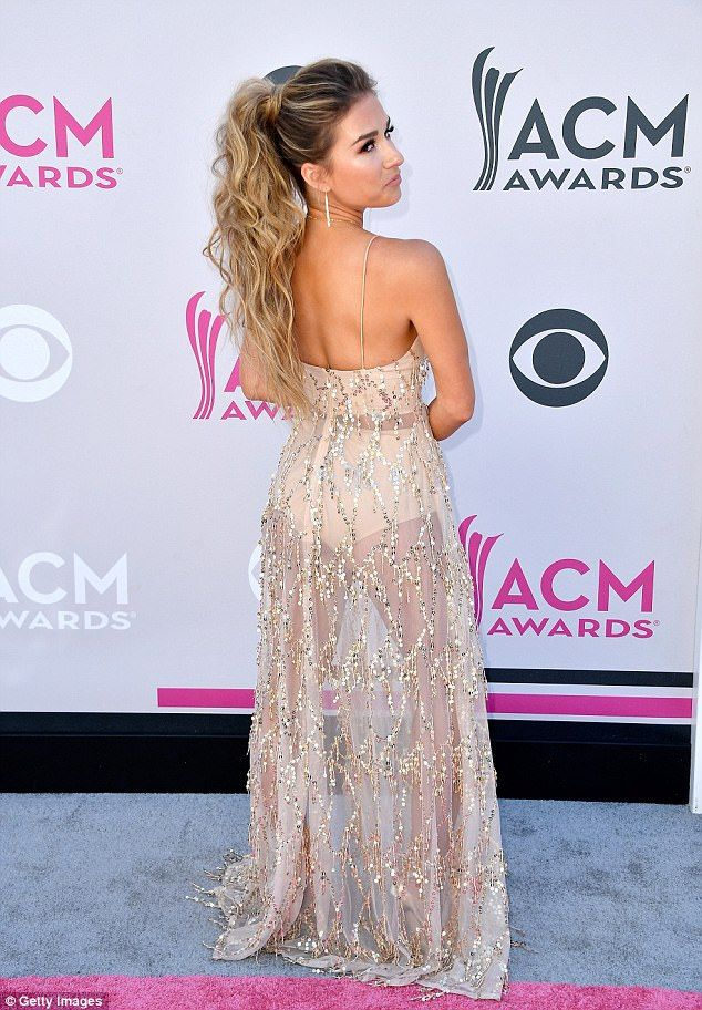 A 10: The 28-year-old beauty wore a sheer gold sparkly dress with a plunging neckline and ...