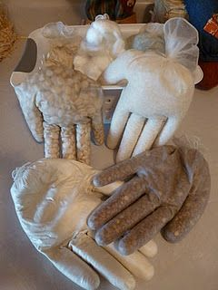 This is a fun idea for reusing medical gloves that don't really get dirty, but you have to throw them away anyway.  So why not?  They're filled with things of different textures (beans, sand, etc.) and used to provide sensory stimulation to little ones and others who need it.  Cool idea!