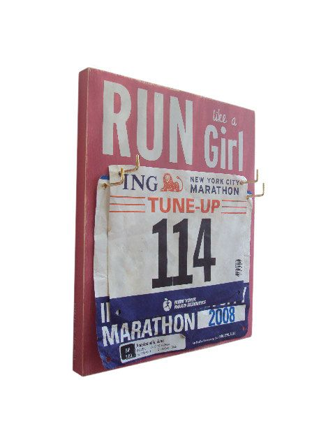 I NEED this! How about you @Alicia Walker? How do you store your bibs?Race Bibs Hanger run like a girl by runningonthewall on Etsy, $26.00