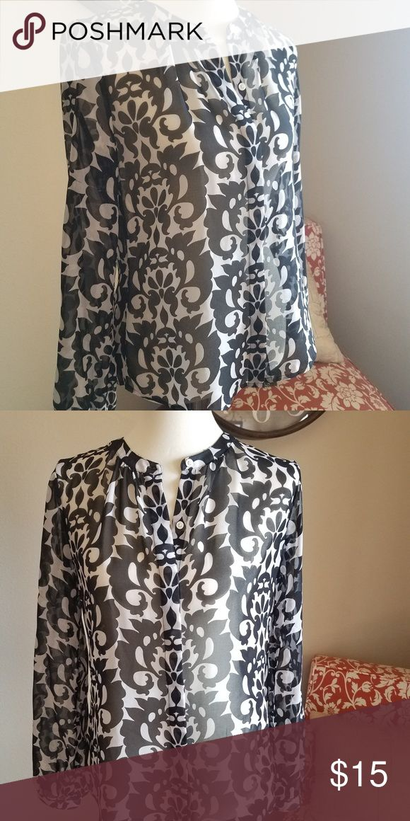 Black & White Patterned Blouse fr. Banana Republic This sheer patterned blouse pairs perfectly with a neutral cami and a blazer for a sharp look that still shows your personality at the office. Banana Republic Tops Blouses