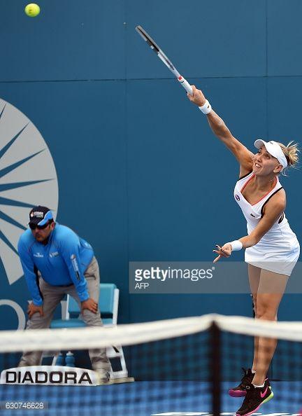 Elena Vesnina of Russia serves against Alize Cornet of France... #elena: Elena Vesnina of Russia serves against Alize Cornet of… #elena