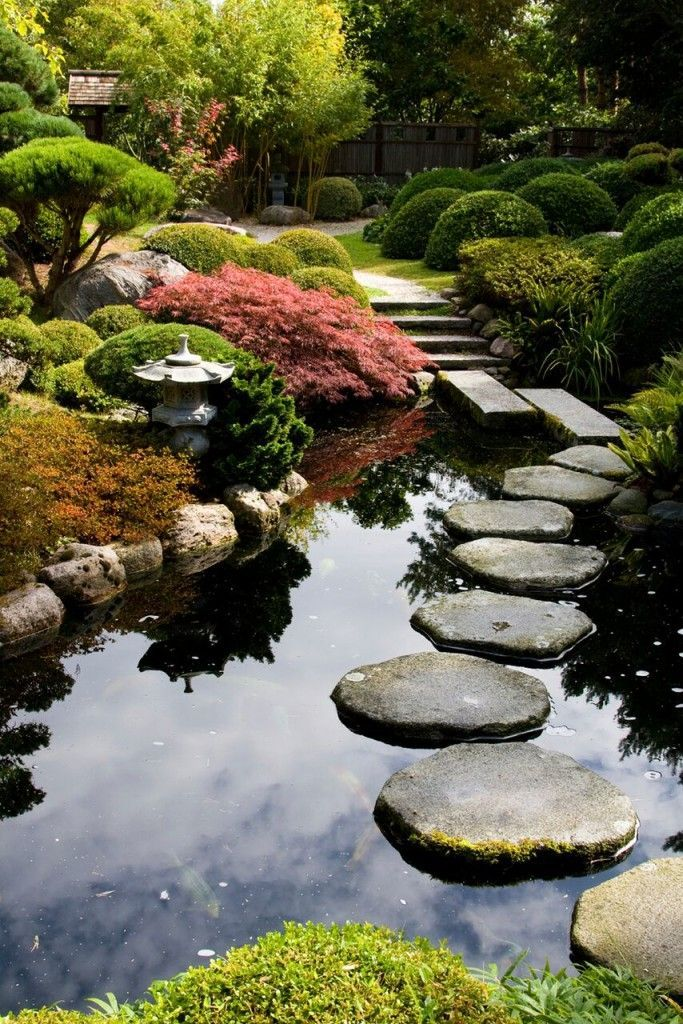 This balanced garden has a natural and asymmetric pond. Ponds are common in Japanese gardens. These ponds often have koi fish in them. These fish can bring even more wonderful color and life to your space.