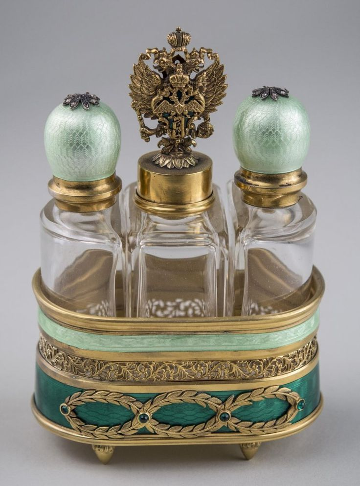 Antique Vintage Silver & Enamel Scent Perfume Set -- Silver gilt tray, with three glass bottles, green guilloche enamel decoration, jewel accents. Overall, height 5 1/2 inches.