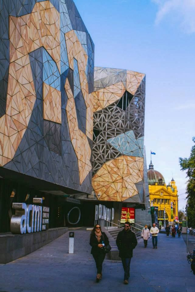 The iconic Federation Square with Flinders Street Station entrance in the background.