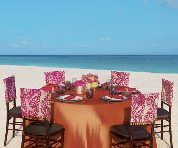 Pink And Orange Table Setting For Beach Wedding Reception