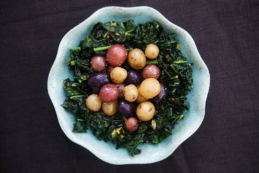 Dinosaur Kale with Baby Potatoes ~ Dinosaur kale, also called Lacinato or black kale, sautéed with garlic and olive oil and serve with poached baby potatoes. ~ SimplyRecipes.com