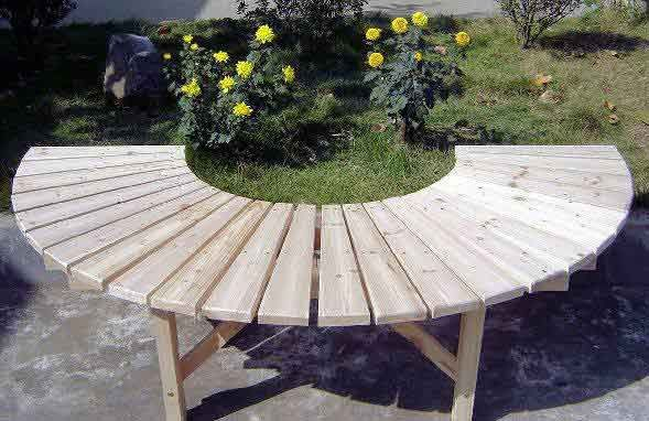 tree benches outdoor | Full circular tree bench with no back support in a public park.