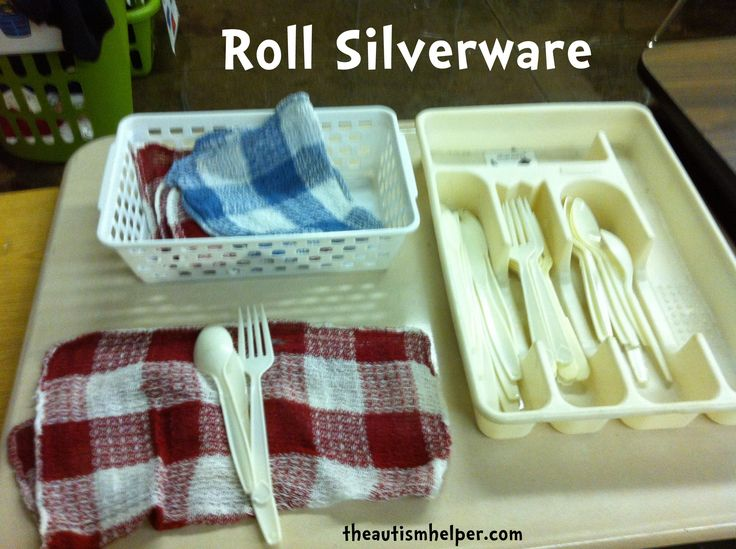 This is a class room set up,and she is teaching the task of rolling silverware, rather than sorting it,but this small silverware holder is exactly the type we'd want in a Functional Fine Motor Box. And you could use a similar basket to the one shown for the mixed silverware before it is sorted.