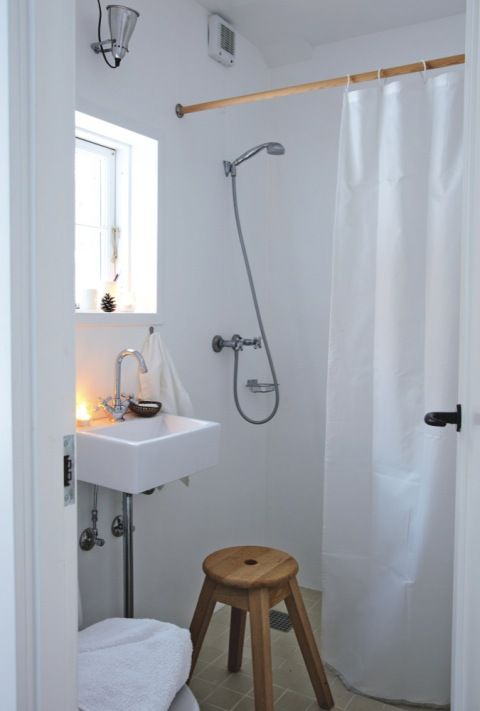 Great solution for small space. Wet room. This is one of the best solutions I think! Love the simple white curtain..nothing fussy.