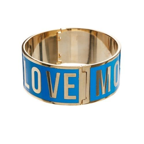 Made from sturdy metal, the Love Moschino Women's Logo Bracelet - Blue will add a touch of vibrancy to any outfit. With 'Love Moschino' lettering that works around the bracelet, it allows for instant brand recognition. - L.M.'Love Moschino' letteringFlawless Bangle new in box