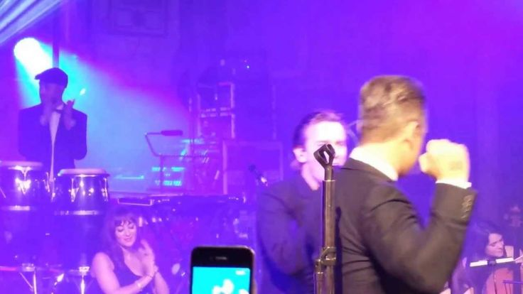 Robbie Williams and Ewan McGregor singing Angels at the Unicef Halloween...