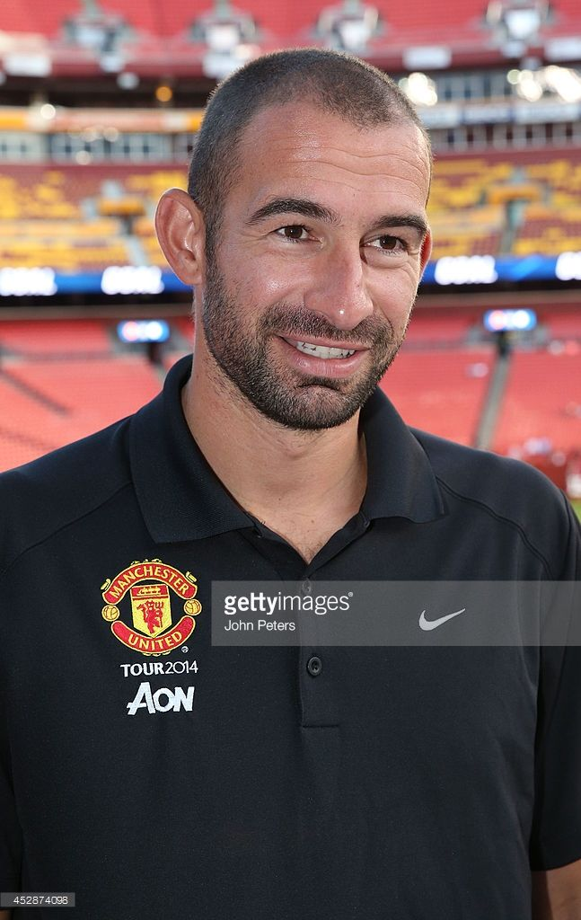 Former player and now MUTV pundit Danny Higginbotham of Manchester United watches from the stand during an open training session as part of their pre-season tour of the United States at FedExField on July 28, 2014 in Landover, Maryland.