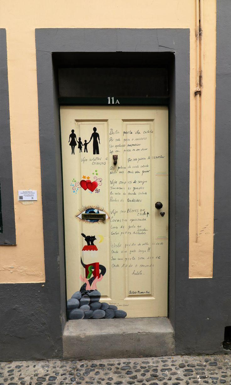 Art work by local artists on the doors down Rua Santa Maria, Funchal