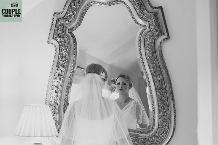 The bride gets her first look at her finished bridal look. Weddings at Rathsallagh House Hotel by Couple Photography.