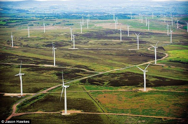 """""""A wind farm in Lanarkshire - some UK wind farms have more than 100 turbines. In Britain, onshore wind farms are subsidised by a levy on consumer bills at 100 per cent; offshore wind is subsidised at 200 per cent."""""""