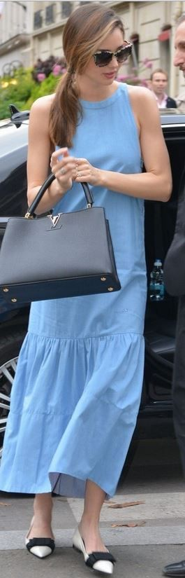 Who made  Miranda Kerr's blue maxi dress, black handbag, sunglasses, and white bow shoes that she wore in Paris?