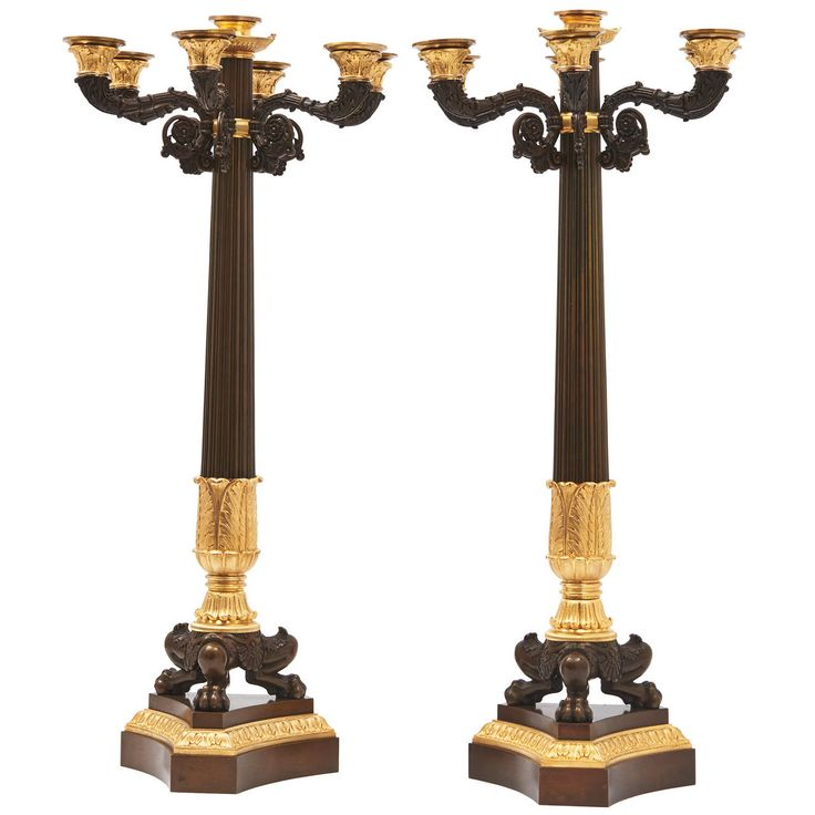 Pair of French Louis Philippe Bronze and Ormolu Triform Base Candelabra | From a unique collection of antique and modern candle holders at https://www.1stdibs.com/furniture/decorative-objects/candle-holders/