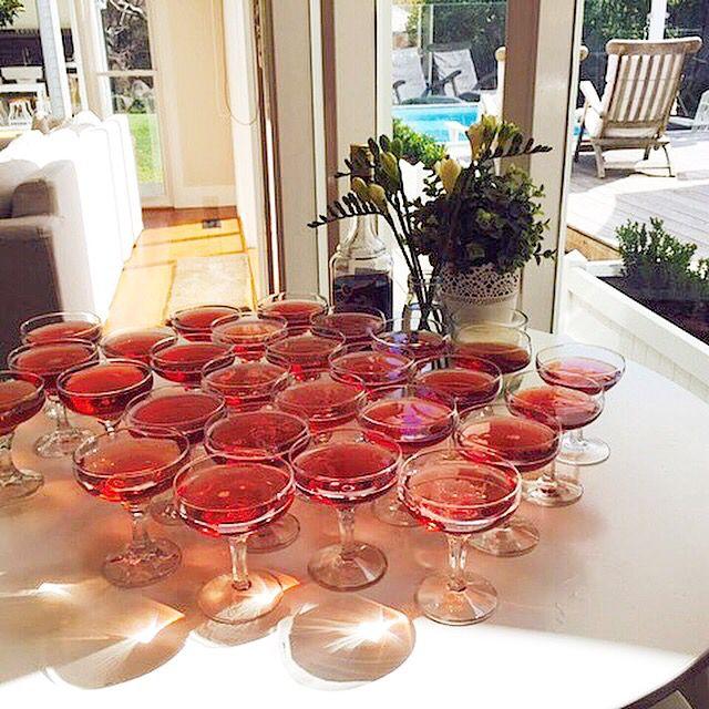 Kir Royale starter drinks. Champagne saucers.