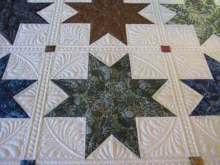 Beautiful longarm quilting by Esther of Threads on the Floor: Star quilt progress