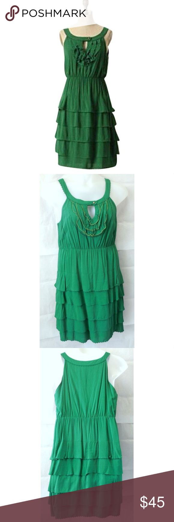"""Maeve GATHERED TOGETHER Tiered Rayon Lovely """"Gathered Together"""" dress from Maeve in emerald green rayon. Machine wash. Features:  Sleeveless ruffled keyhole neckline elasticized waist tiered skirt fully lined in green cotton Measurements:  Size 14 Bust 41"""" Waist 30"""" Hips 40"""" Length 39"""" shoulder to hem  All Measurements Are Approximate  Measurements Taken Flat & Unstretched Anthropologie Dresses Midi"""