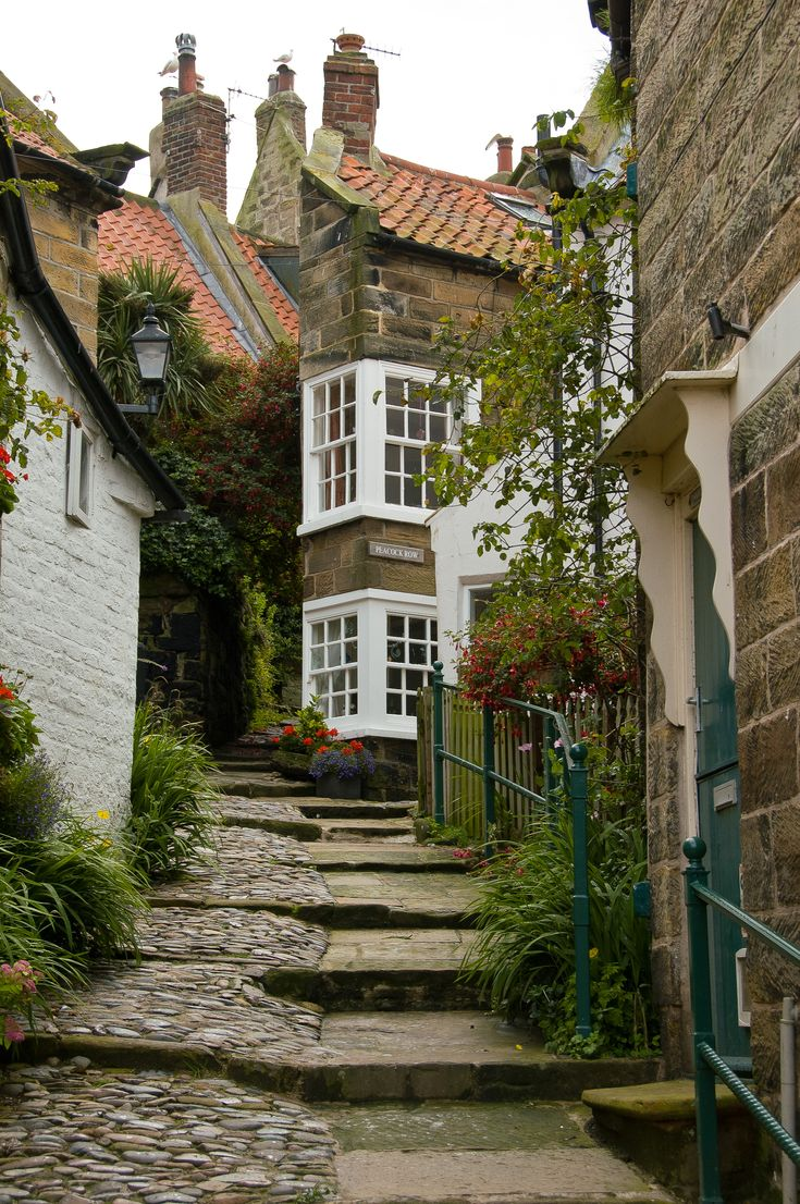 Robin Hood's Bay is a small fishing village and a bay located within the North York Moors National Park, five miles south of Whitby and 15 miles north of Scarborough on the coast of North Yorkshire, England.