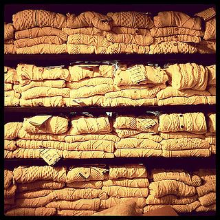 Aran sweaters stacked at the Aran Sweater Market on Inis Mor, Aran Islands