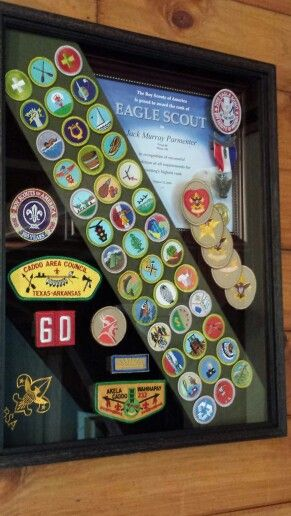 Jack's Eagle Scout shadow box - finally - 3 1/2 years later..... made using spray adhesive to black foam board and foam weather stripping (sticky on both sides) to add height. Certificate in frame and it can all be disassembled later if wanted.  The sash is folded around foam board without adhesive. Love my Eagle Scout! (uploaded from my photos - Missy Parmenter)
