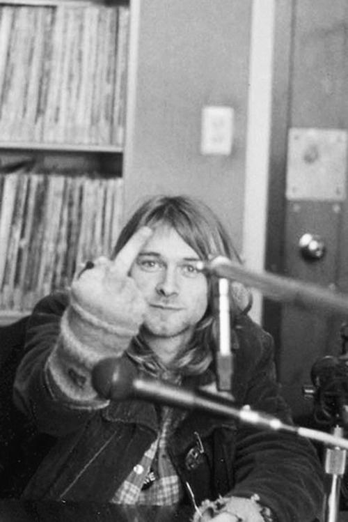 Kurt Cobain   singer   songwriter   famous   music   recording   single finger salute   cheeky   black & white photography   www.republicofyou.com.au