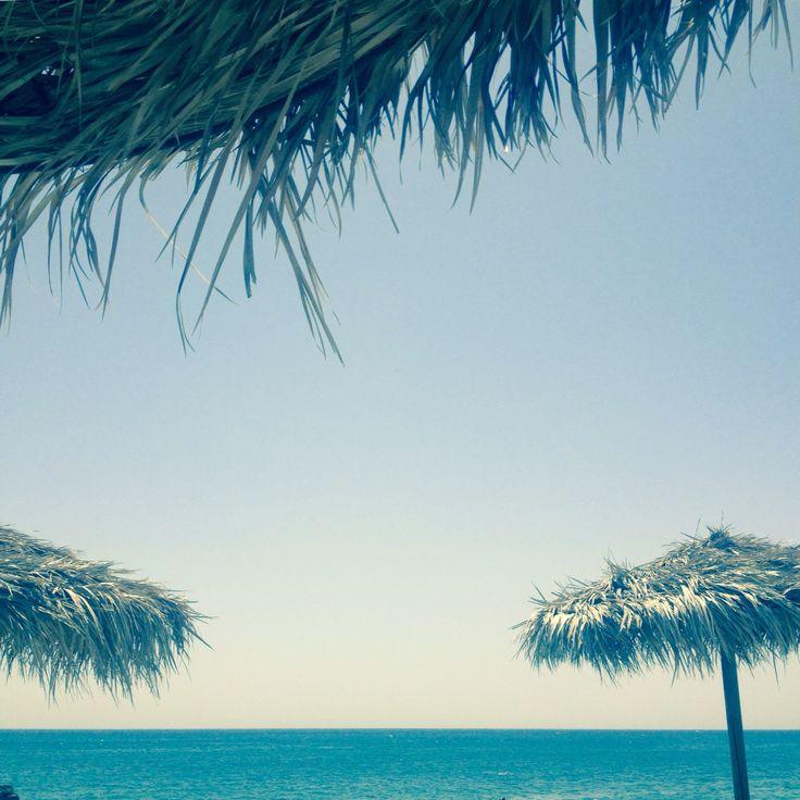 Relax on the beach.. Lovely Summer in Santorini