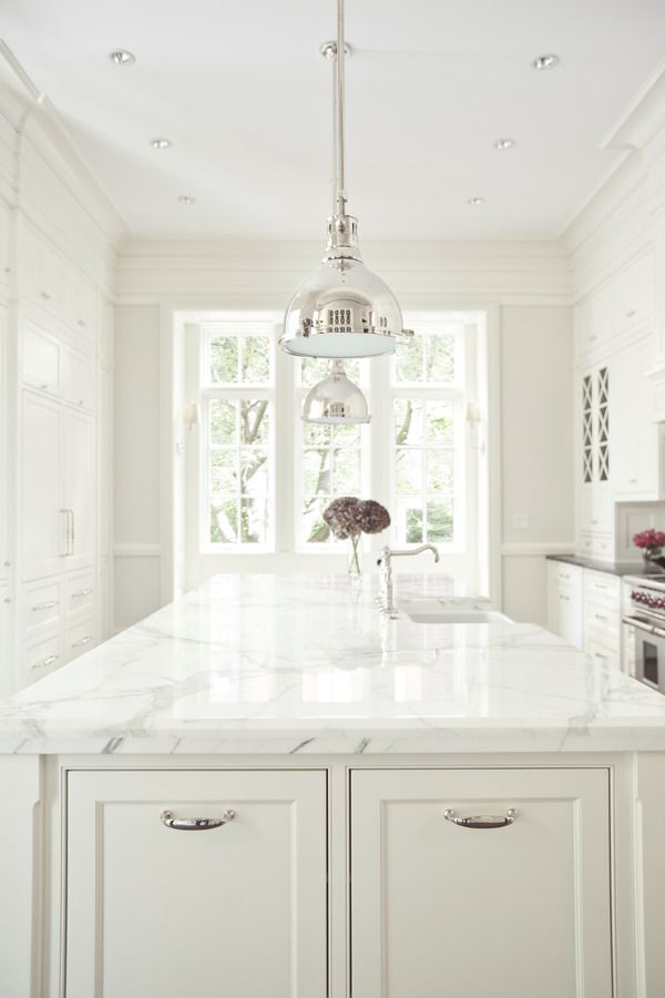 Classic white kitchen...love the chrome lights, cabinets, X mullions