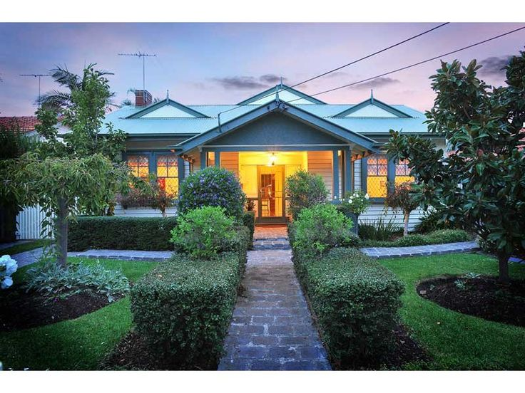 Weatherboard Californian Bungalow House Exterior With Porch Hedging
