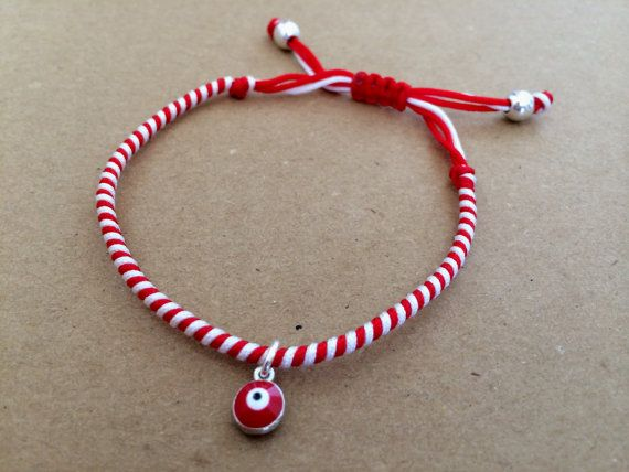 Traditional red and white spiral 'Martis' charm by izou.gr, €8.00