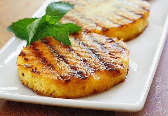 Grilled pineapple with honey, lime juice and cinnamon. Pineapple is delicious on it's own, but if you want something quick and easy to make for dessert this summer, try grilling it and serving it with some ice cream on the side. Fun for backyard parties!