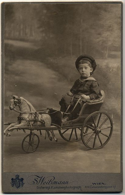 CdV of a boy in sailor suit, ca 1890s sitting in his toy cart