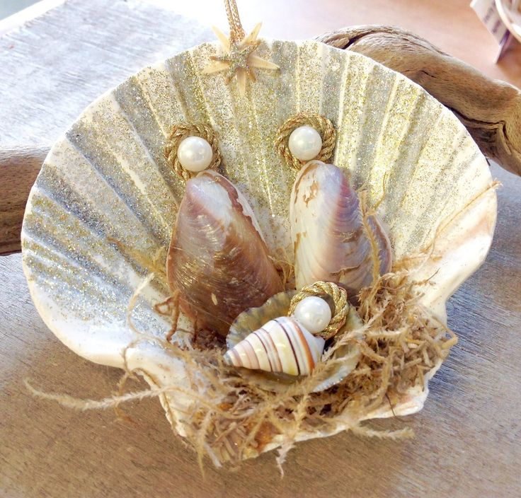 This Seashell Manger Scene Christmas Nativity Ornament is sure to be a favorite. This handmade Nativity Manger Scene Ornament was made here at Sea Things in Ventura, CA. This unique design was created