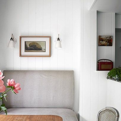 Panelled dining space with banquette seating