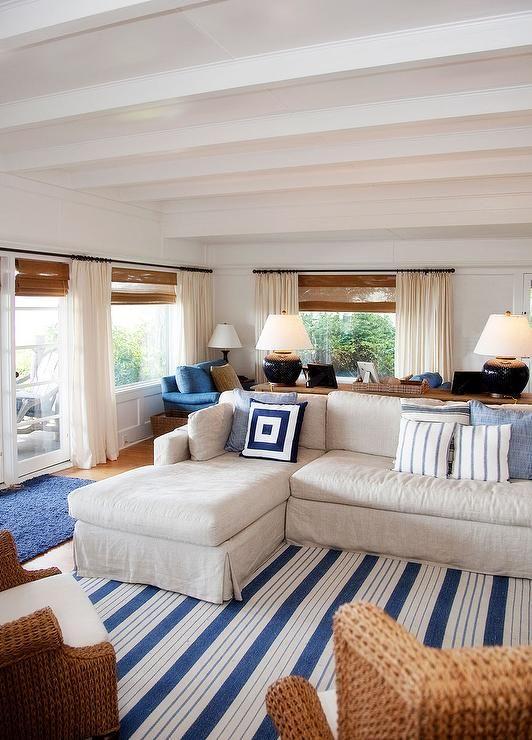 Coastal family room | Benjamin Moore  Simply White,  striped rug