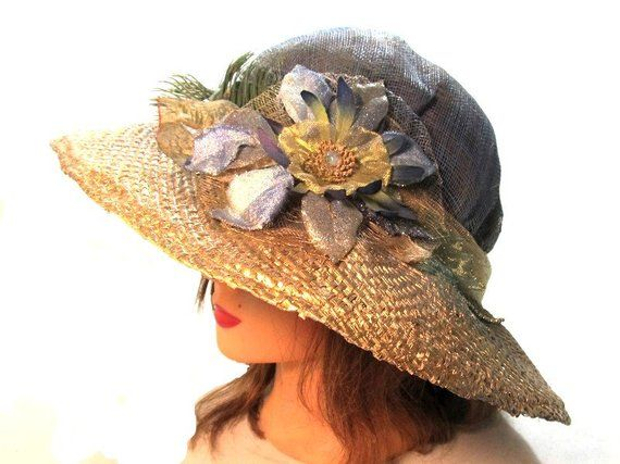 This baby blue and metallic gold womens hat will fit a medium to large size  head f3cbcac68881