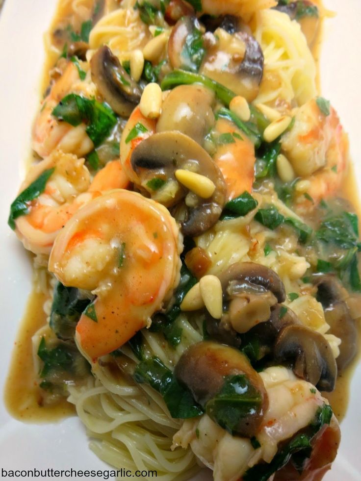 Shrimp Portofino...Shrimp, spinach and mushrooms cooked in a delightful broth served over angel hair pasta!  Delish!