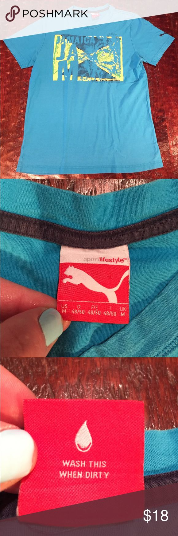 "Puma Jamaica Graphic Tee Medium Puma Jamaica Graphic Tee. Tee is 25 1/2"" from shoulder to hem. Chest measures 19"" laying flat. Tee is in great condition. The laundry label is missing, but this is the only sign of wear. Comes from a Smoke Free/Pet Friendly home. Offers always welcome. Puma Shirts Tees - Short Sleeve"