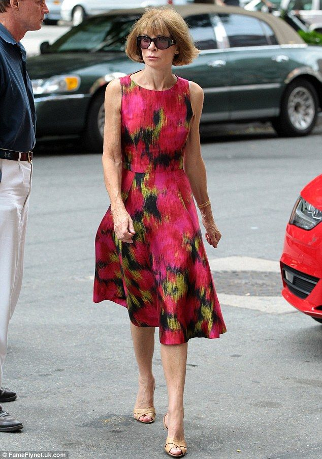 A la mode: Anna Wintour looks crisp in red as she strides into a New York hotel