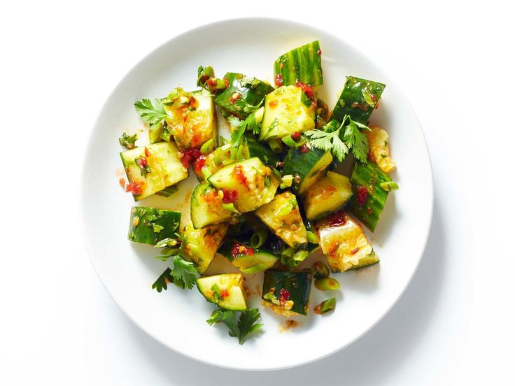 Smashed Cucumber Salad | Add flavor and punch to a simple cucumber salad with Sambal Oelek, a fiery chili paste found on the Asian foods aisle. Combine with nutty sesame oil and fresh green onions, this easy veggie salad is light and refreshing, yet packs a spicy, unexpected kick. Let stand to allow the flavors to mesh before consuming.