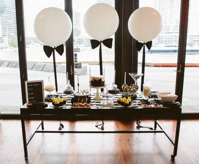 A beautiful Engagement in Melbourne, Australia with the colours white, black and silver, and an elegant theme. A dessert table, handmade items and chalkboard frames