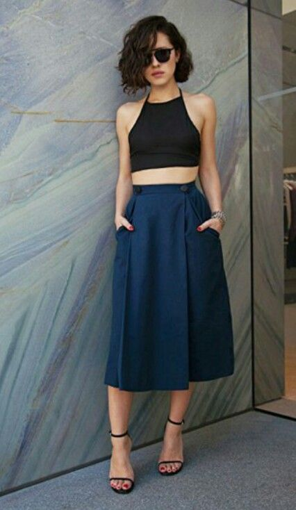 How to wear a crop top.  If your shoulders are a wee bit more broad than your hips, then a halter crop top is a great way for you to go. It minimizes the width of your chest and torso, while still highlighting your waist. Pair it with a full skirt to amplify your hips for maximum feminine effect.  Photo: Karla's Closet and stylecaster.com