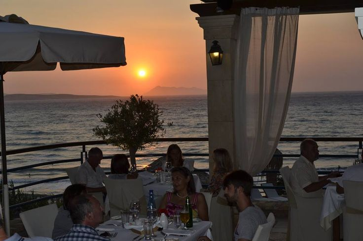 Dining while the sun sinks into the deep blue sea...