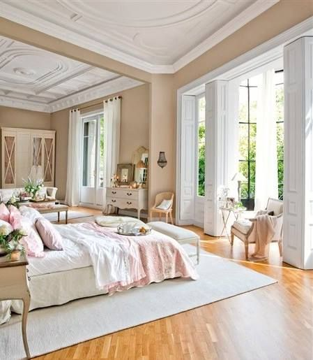 I die for this beautiful open bedroom space, particularly the high ceilings and airy windows