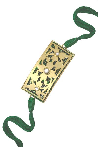 Gold Imprint Rakhi | Ra Abta | Rakhi Jewelry | Ultimate Rakhi Guide | ( http://purplevelvetproject.com/guide-rakhi-jewelry/ ) | Unique Rakhi Ideas | Rakhi Design | DIY Rakhis | Rakhi Lumba | Raksha Bandhan | Thali | Indian Festival | Modern Rakhis | Traditional Rakhis | Brother | Sister | Sister In Law | Bhabhi | Personalised Rakhis |Rakshabandhan | Fancy Rakhis | Designer Rakhis | Beautiful | Awesome | Creative | Fun Rakhis | Quirky Rakhis | @purplevelvetpro